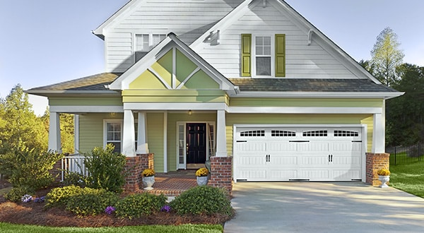 Green Home with White Garage Door