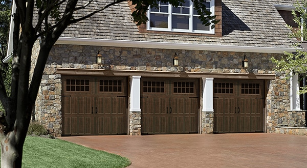 Triple Wooden Style Garage Doors Full View