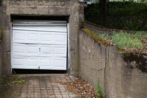 damaged-white-garage-door