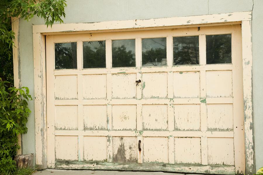 wear and tear on wooden garage door