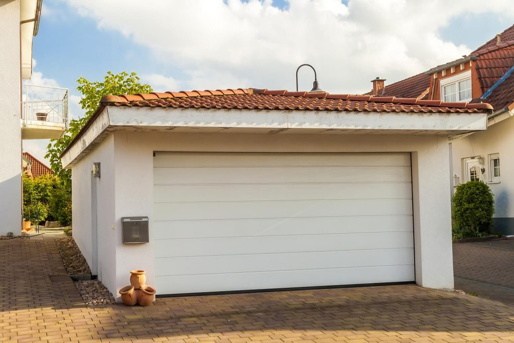 Detached-White-Garage-With-Tile-Roof