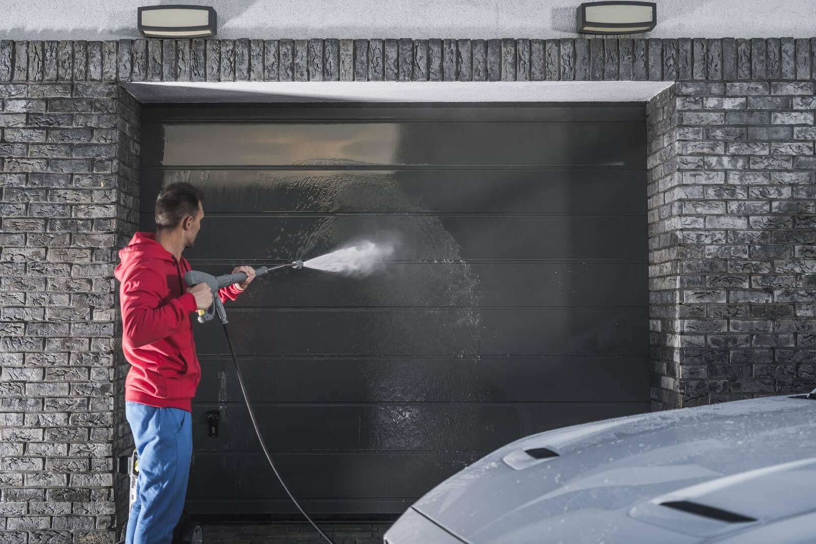 Man-Pressure-Washing-Garage-Door