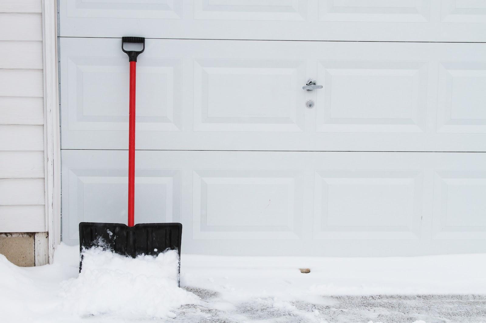 snow-shovel-white-garage-door