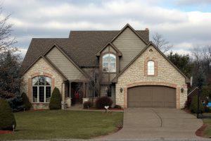 Tudor-Style-Home-with-Carriage-Garage-Door