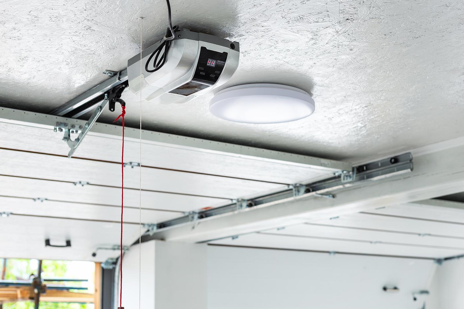 Opening-Door-And-Automatic-Garage-Door-Opener-Mounted-on-Ceiling-with-Emergency-Cord