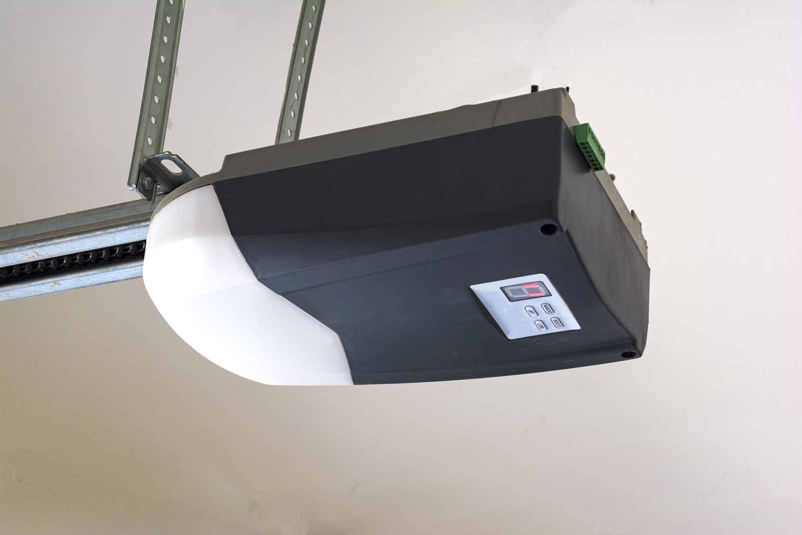 Close-Up-Of-An-Automatic-Garage-Door-Opener-on-Ceiling