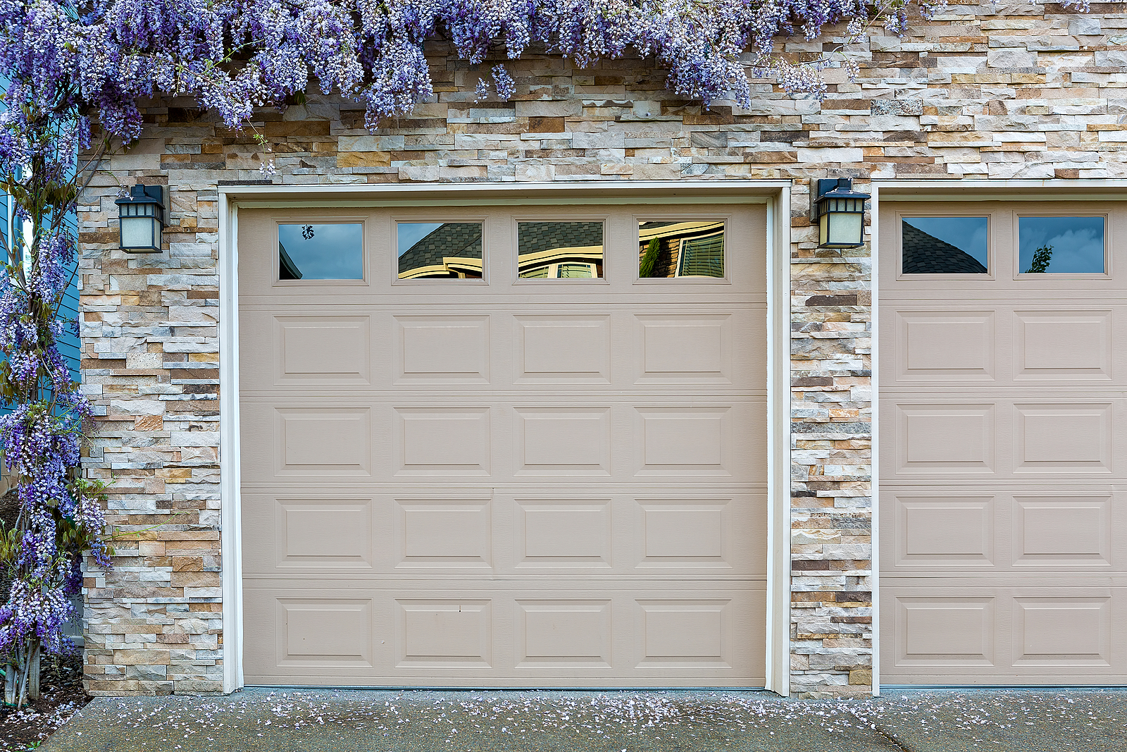 House-Front-with-Two-Beige-Garage-Doors-and-Wisteria-Growing-on-Wall