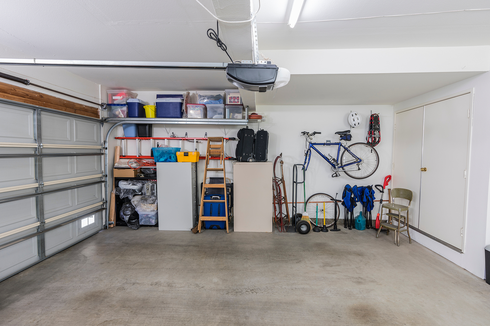 Organized-Residential-Two-Car-Garage-with-Tools-File-Cabinets-and-Sports-Equipment