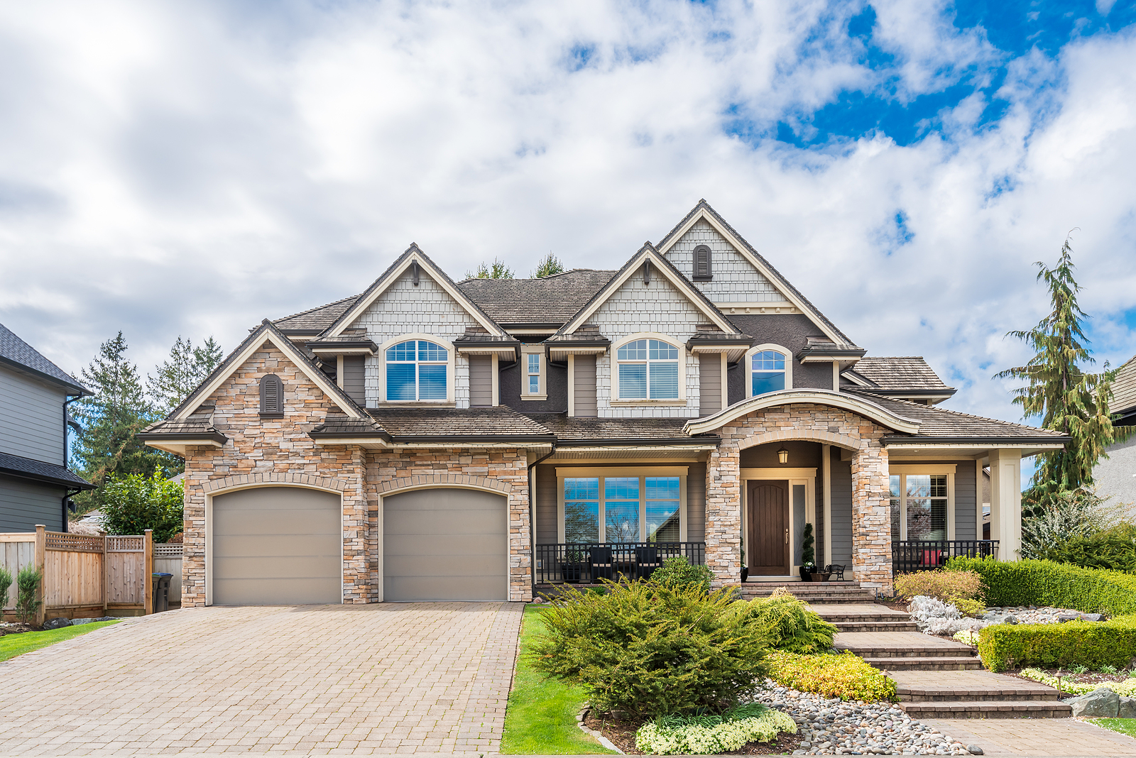 Beautiful-Exterior-of-Newly-Built-Luxury-Home-with-Two-Garage-Doors