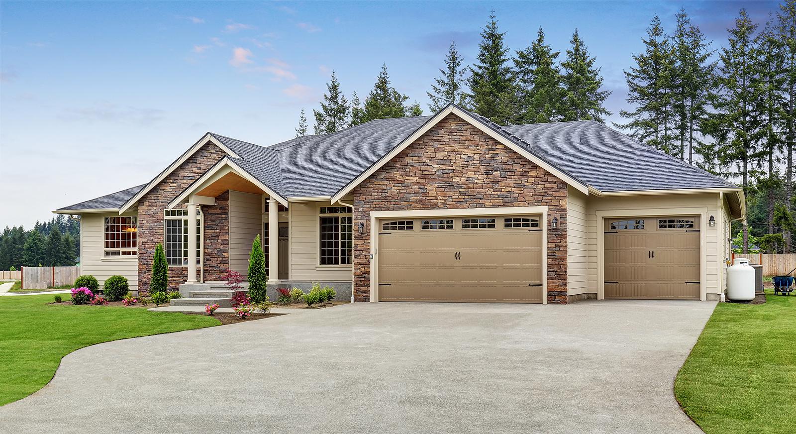 Luxury-One-Level-House-Exterior-with-Brick-Trim-Garage