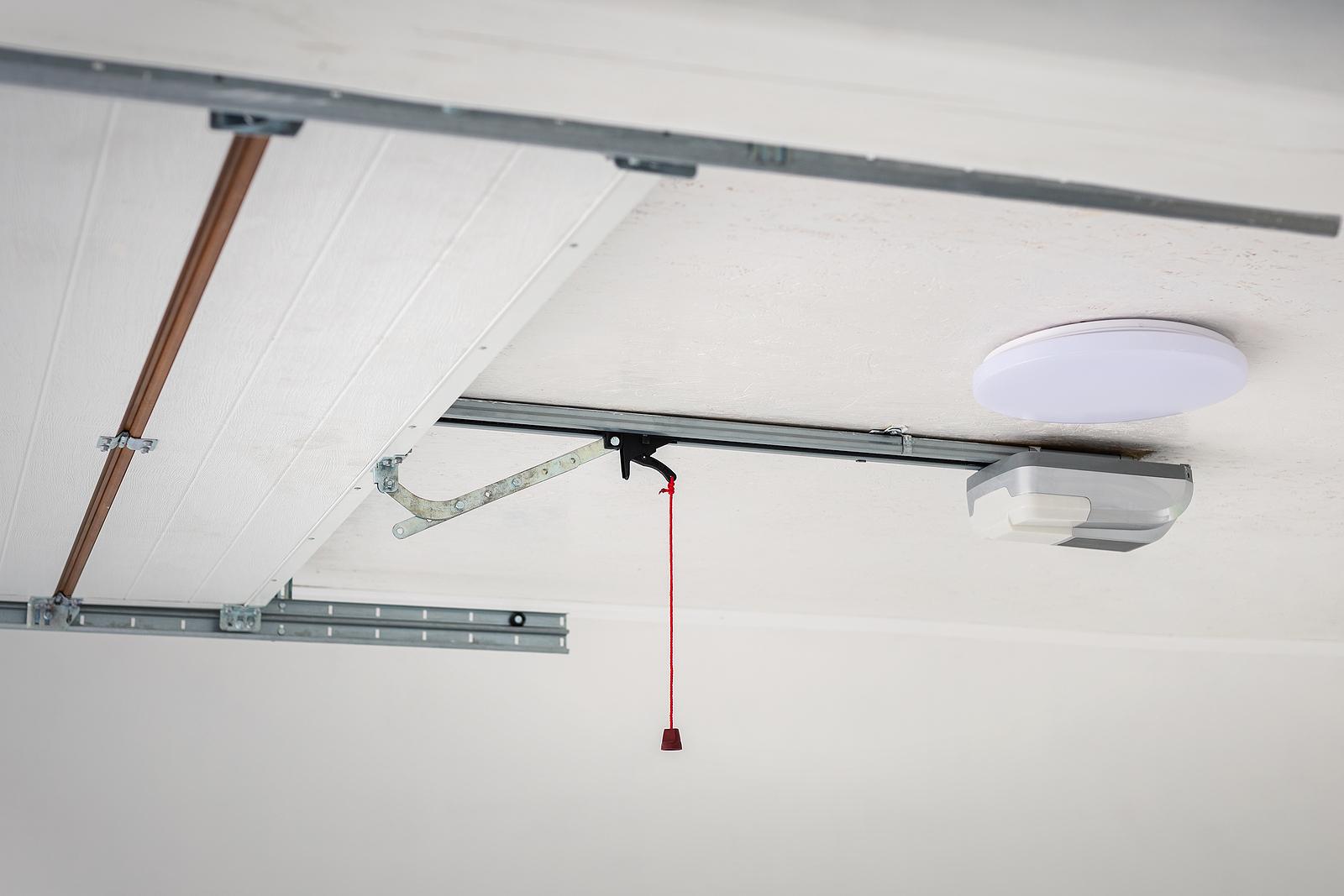 Opening-Garage-Door-And-Automatic-Garage-Door-Opener-Mounted-on-Ceiling-With-Emergency-Cord